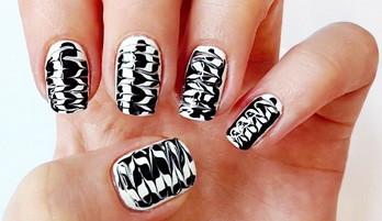 Ungewöhnliche schwarze und weiße Nageldesign
