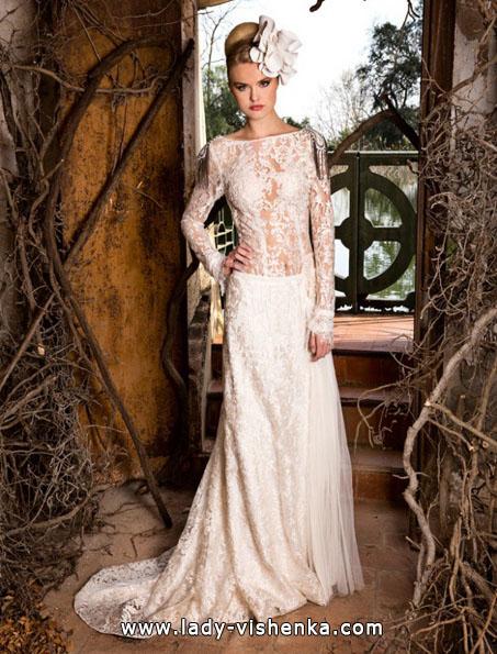 Brautkleider mit Spitzen ärmeln Foto - Jordi Dalmau